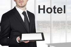 Businessman holding tablet hotel Royalty Free Stock Image