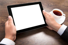 Businessman holding a tablet with isolated screen over the villa stock images