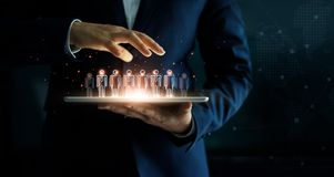 Businessman holding tablet and management group of people royalty free stock photography