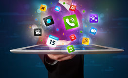 Businessman holding a tablet with modern colorful apps and icons Stock Photo