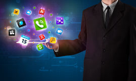 Businessman holding a tablet with modern colorful apps and icons Royalty Free Stock Images