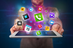 Businessman holding a tablet with modern colorful apps and icons Stock Image