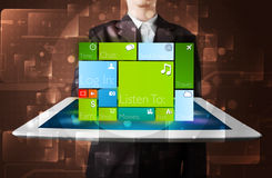 Businessman holding a tablet with modern software operational sy Royalty Free Stock Photos