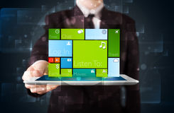 Businessman holding a tablet with modern software operational sy Stock Images