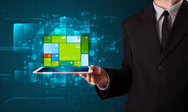 Businessman holding a tablet with modern software operational sy Stock Photography