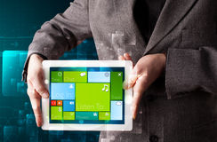 Businessman holding a tablet with modern software operational sy Royalty Free Stock Image