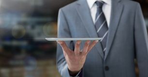 Businessman holding tablet in night city stock photography