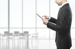 Businessman holding tablet Stock Photo