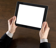 Businessman Holding Tablet PC. Businessman hands are holding the touch screen device Stock Photography