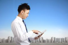 Businessman holding tablet pc Stock Photos