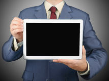 Businessman holding tablet Royalty Free Stock Photos