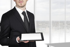 Businessman holding tablet white display Stock Image