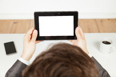 Businessman holding a tablet Stock Photo