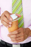 Businessman holding takeout coffee Stock Photo