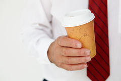 Businessman holding takeout coffee cup Royalty Free Stock Images