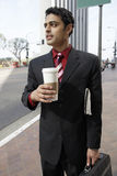 Businessman Holding Takeout Coffee Cup On City Street stock image