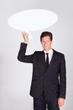 Businessman Holding Talking Bubble Royalty Free Stock Images