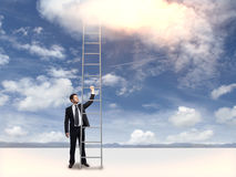 Businessman holding tall ladder Stock Photo