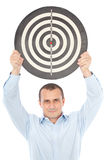 Businessman holding target above his head Royalty Free Stock Photography