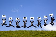 Businessman holding teamwork text and jumping Royalty Free Stock Photo