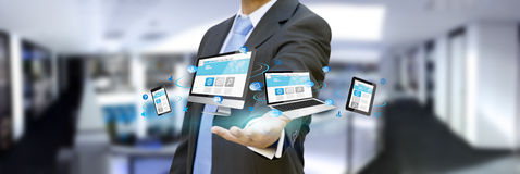 Businessman holding tech device in his hand Royalty Free Stock Photos