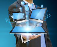 Businessman holding tech device in his hand. Businessman with computer phone and tablet in his hand Royalty Free Stock Photography