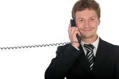Businessman holding a telephone handset Stock Photos