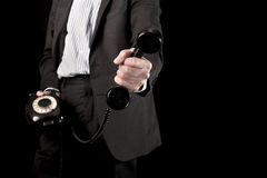 Businessman holding telephone handset Royalty Free Stock Photo