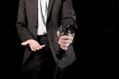 Businessman holding telephone handset Stock Photography