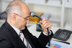 Businessman Holding Telephone Receiver Stock Photography
