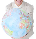 Businessman holding a terrestrial globe Stock Image