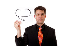 Businessman is holding a text balloon Stock Photography