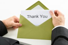 Businessman holding thank you card Stock Photo