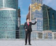 Businessman holding three ballon Stock Photos