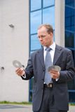 Businessman holding three CD/DVDs Royalty Free Stock Images