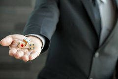 Businessman holding three dices Royalty Free Stock Image