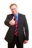 Businessman holding thumb up Stock Images