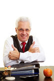Businessman holding thumbs up Stock Photo