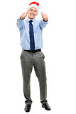 Businessman holding thumbs up for Christmas isolated on white ba Royalty Free Stock Photos