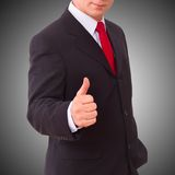 Businessman holding thumbs up Stock Photos
