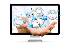 Businessman holding time of the world in his hand. Businessman going out of a computer screen holding time of the world in his hand Stock Photo
