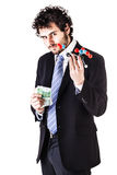Businessman holding a tnt molecule and money Stock Images