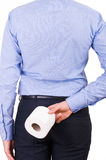 Businessman holding toilet paper behind his back. Royalty Free Stock Photos