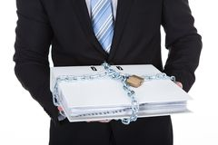 Businessman holding a top secret file Stock Photo