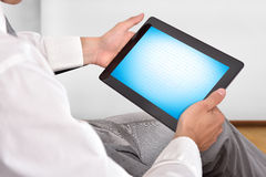 Businessman holding touch pad Stock Photography