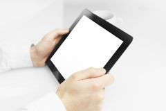 Businessman holding touch pad Royalty Free Stock Image