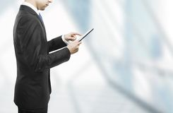 Businessman holding touch pad Royalty Free Stock Photos