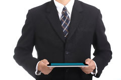 Businessman holding touch pad Royalty Free Stock Photo