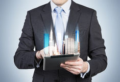 Businessman holding touch pad Royalty Free Stock Photography