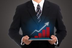 Businessman holding touch pad Stock Image